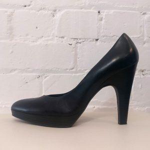 Leather high heels.