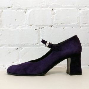 Suede pump with ankle strap.