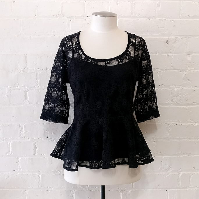 Black cotton lace top with peplin, with silk camisole.