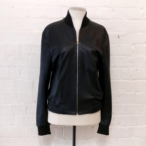 """Black bomber-style leather jacket with """"artist stripe"""" lining."""