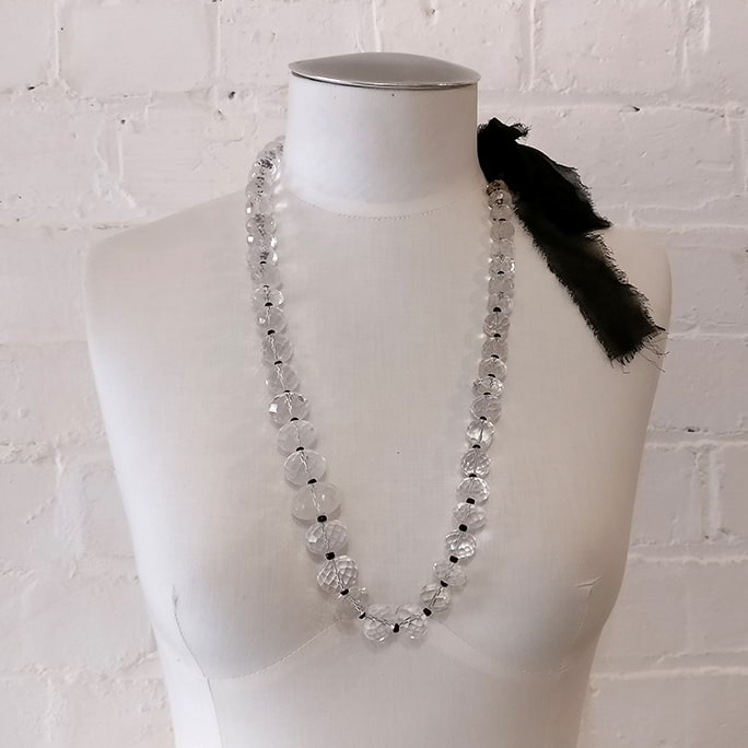 Crystal neck piece on silk ribbon, with presentation box.
