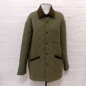 Quilted jacket with corduroy trim.