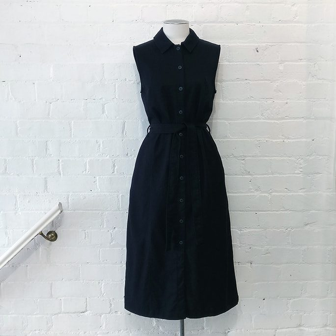 Sleeveless shirt dress with pockets.