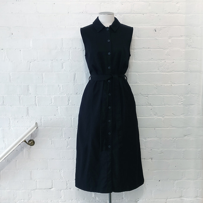 Sleeveless shirt dress with pockets.