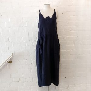 Oversize linen dress with patch pockets.