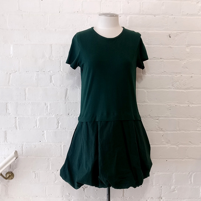 T-shirt dress with puffy skirt and pockets.