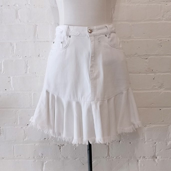 White denim skirt with intentional fraying.