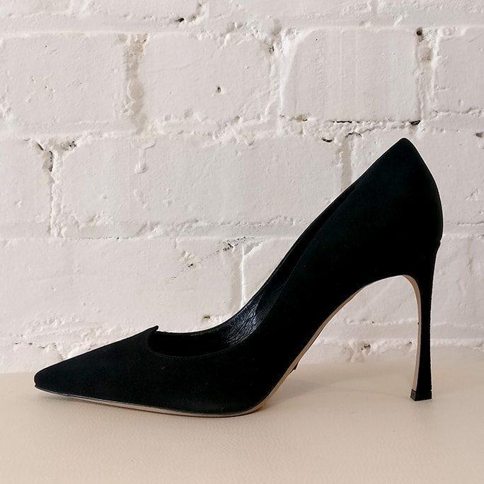 Black suede stilettos. Unworn, has original box.