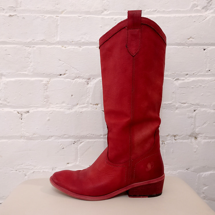 Red leather boot, vintage line.