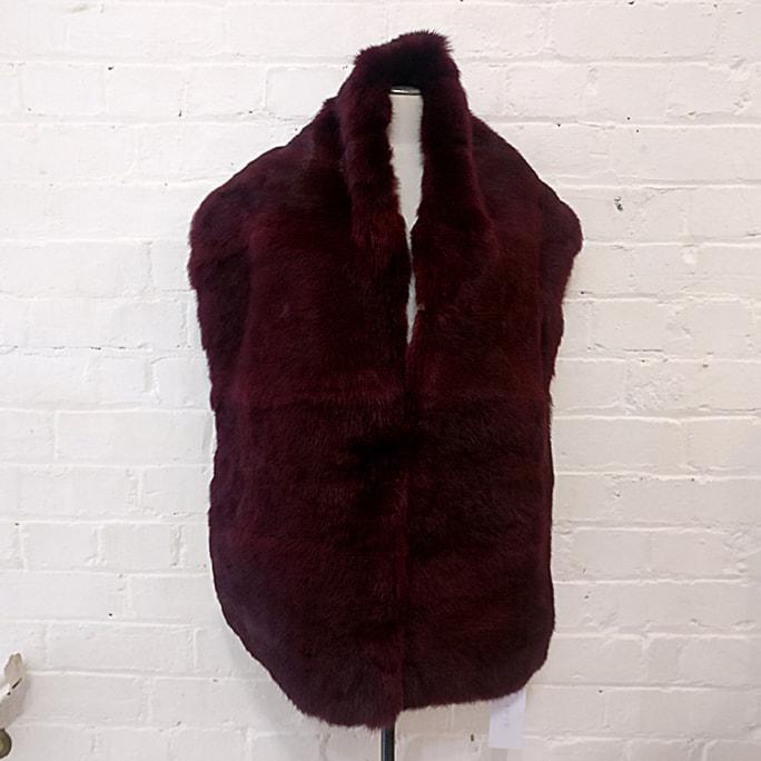 Fur shawl.