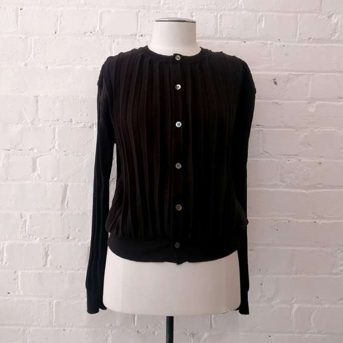 Black pleat sweater.