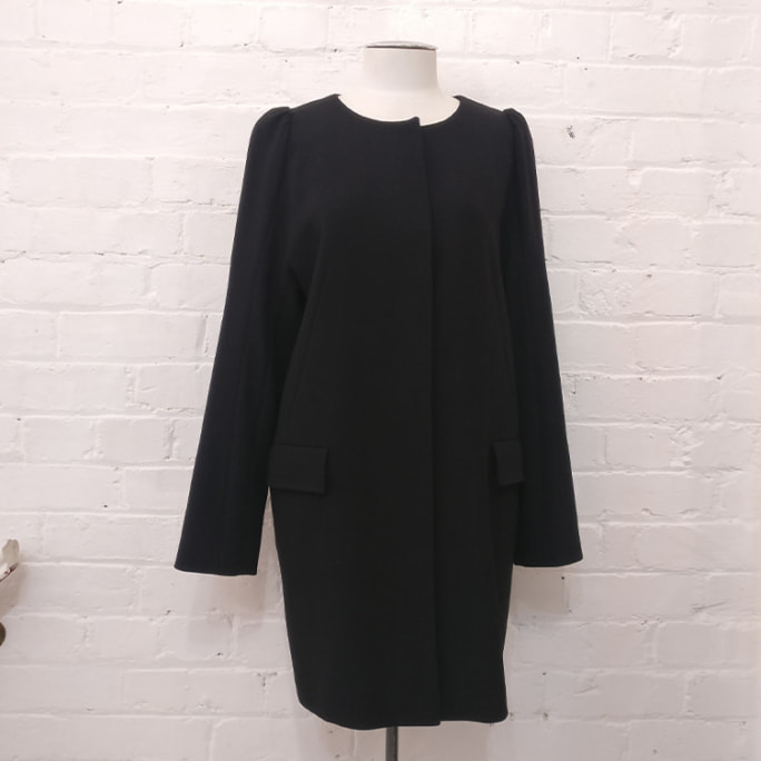 100% wool collarless coat.