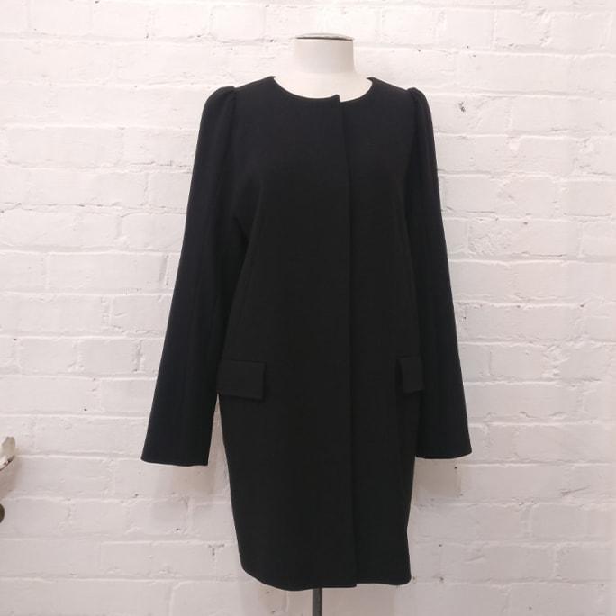 100% wool collarless coat.