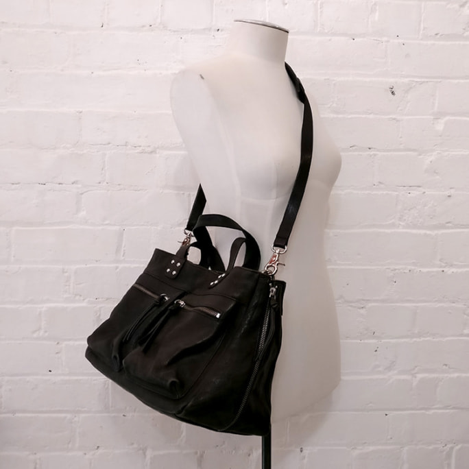 Black leather bag, with floral lining.
