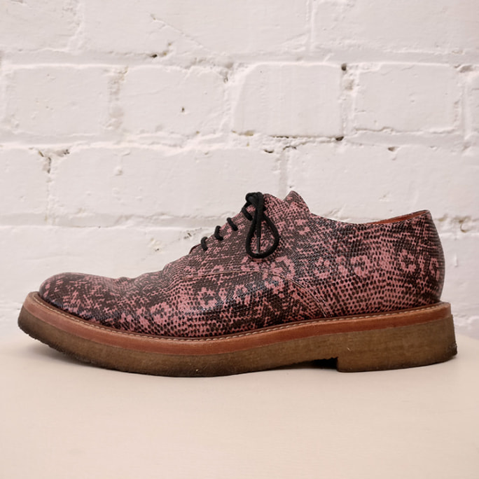 Textured leather lace-up with crepe sole, has box.