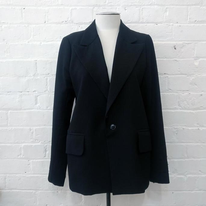 Tuxedo style blazer.