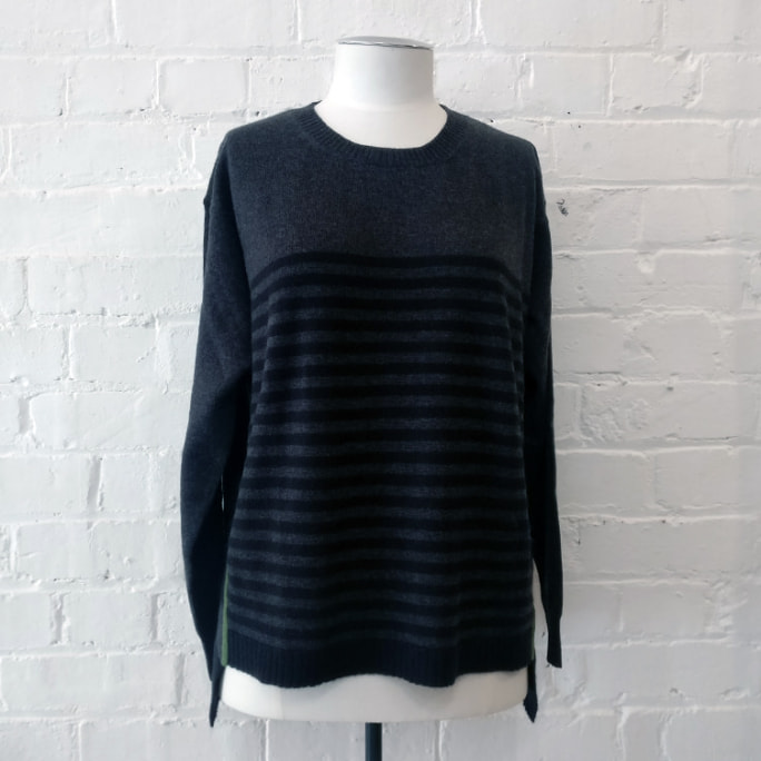 Semi-stripe oversized cashmere sweater with contrast seam.