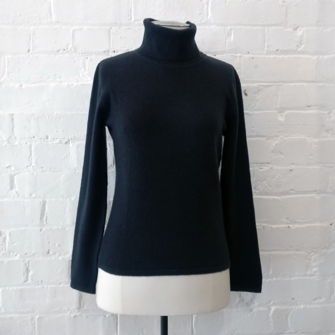 Roll-neck knit top.