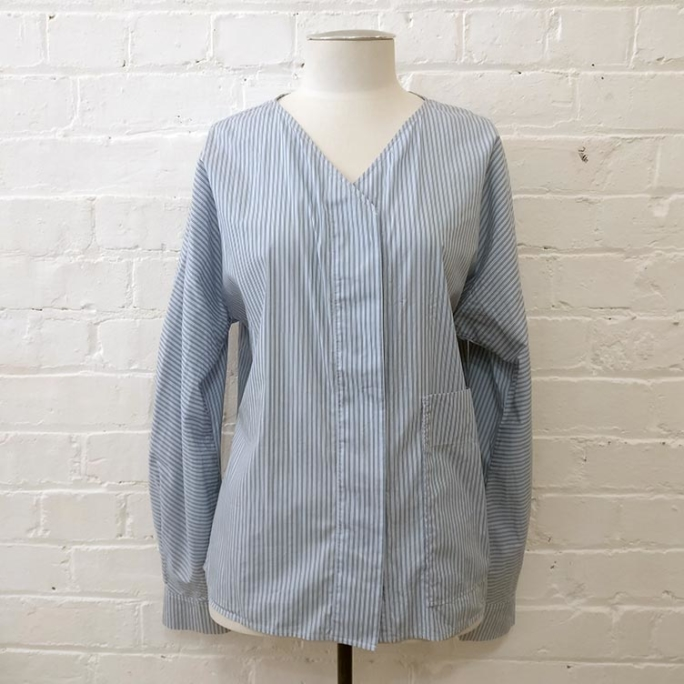 Cotton collarless shirt with patch pockets.