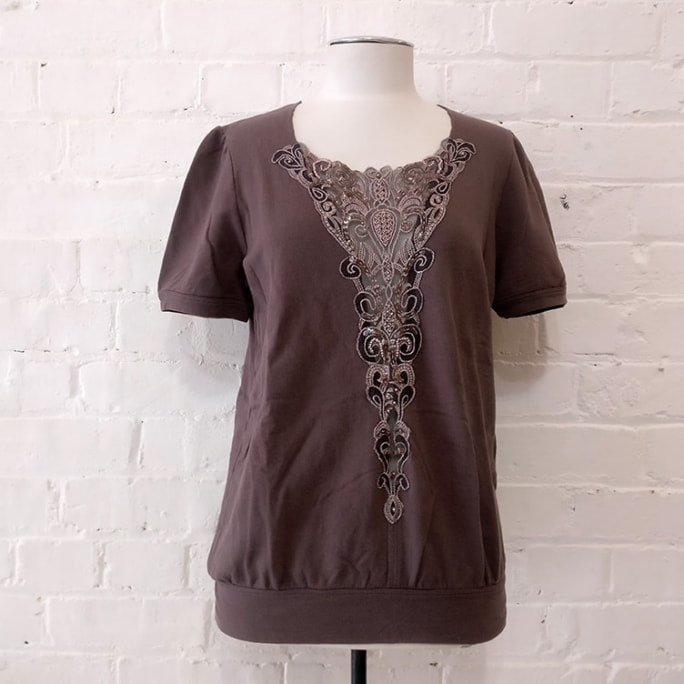 Tee-shirt with embellishment.