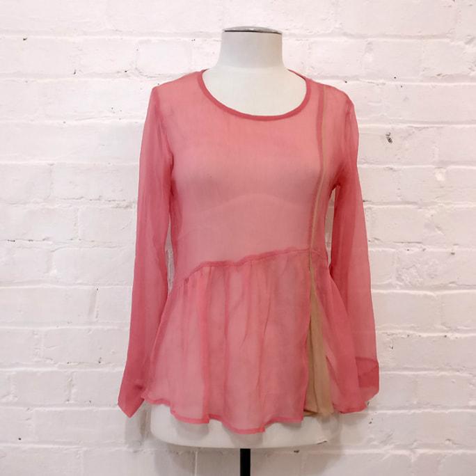 Pink silk top.