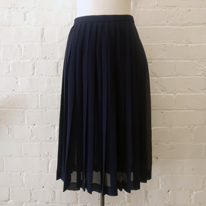 Pleated skirt with single pocket.