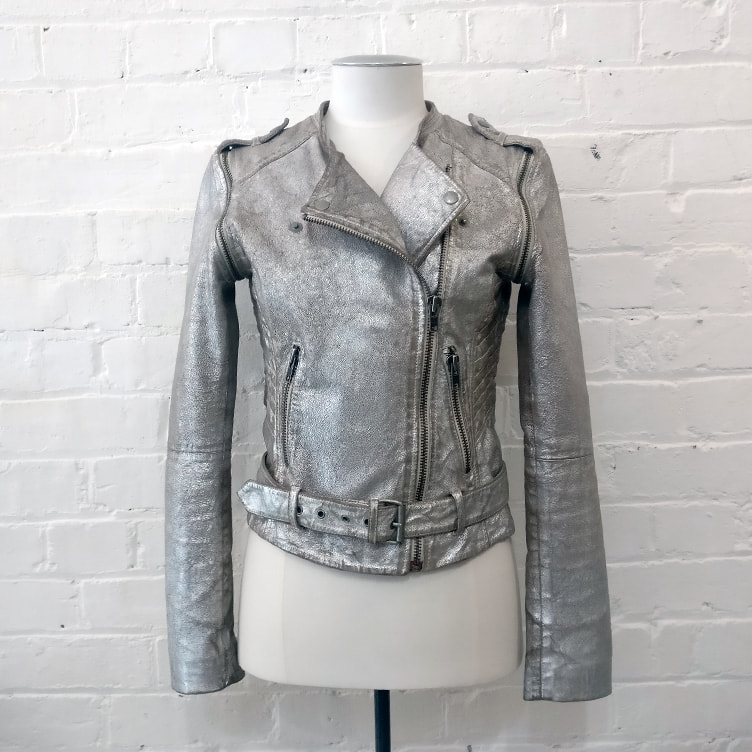 Distressed silver biker-style leather jacket with slip-off sleeves.
