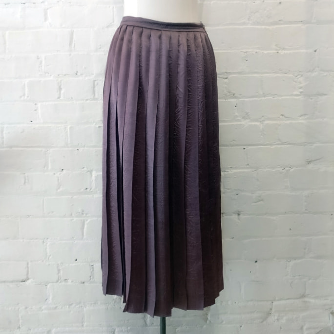 Metallic pleated skirt.