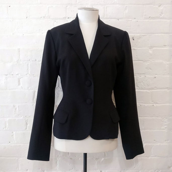 100% wool tailored jacket, lined.