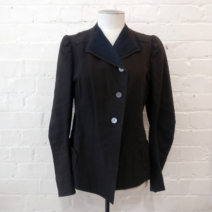 Heavy canvas military-style jacket, with pockets.