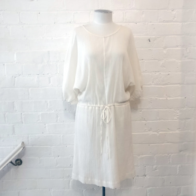 100% cotton drop-waist dress with short sleeves, half-lined.