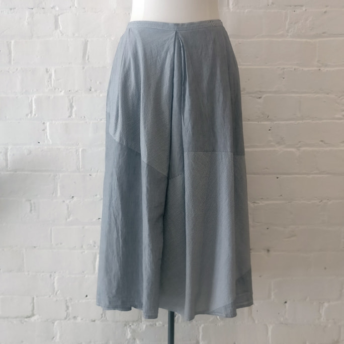 100% cotton skirt with pocket, lined.