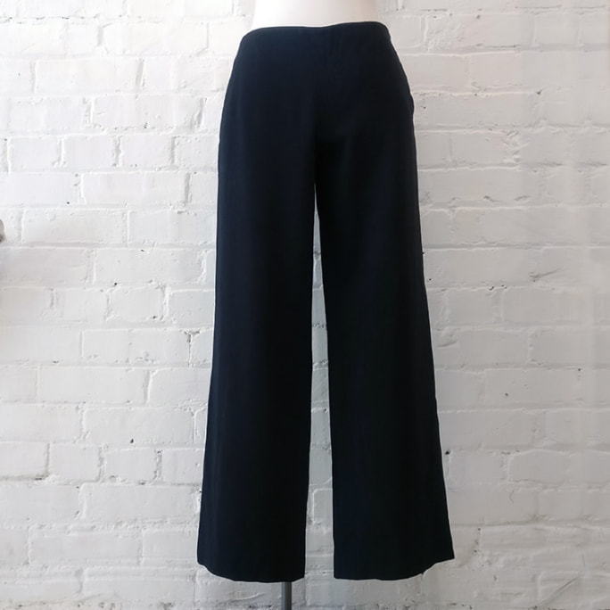Black trousers with wide leg and side zip.