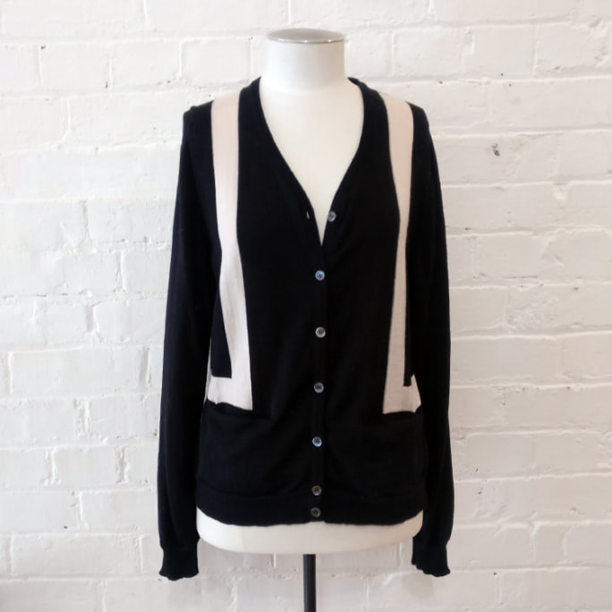 100% wool cardigan with pockets.