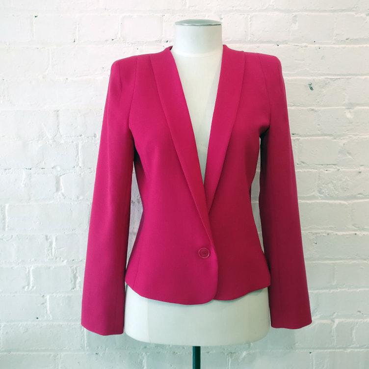 Pink crop jacket.