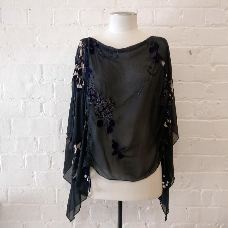 Silk drapey top.