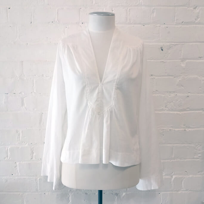 Cotton peasant-style top with bell sleeves.