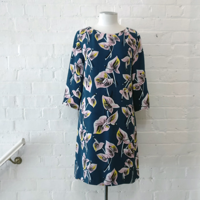 Floral print dress with 3/4 sleeve, lined.