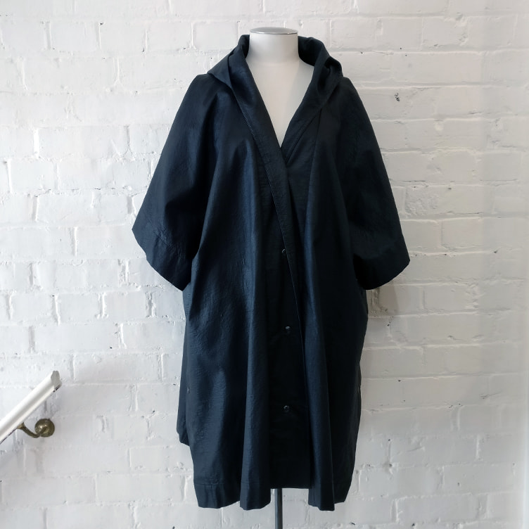 Short sleeved hooded poncho.