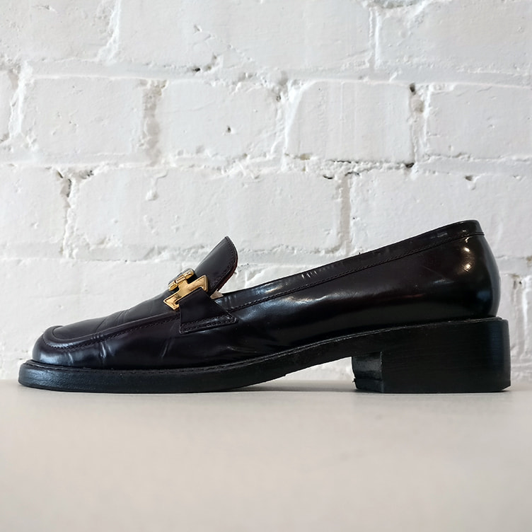 Chocolate brown leather loafer.