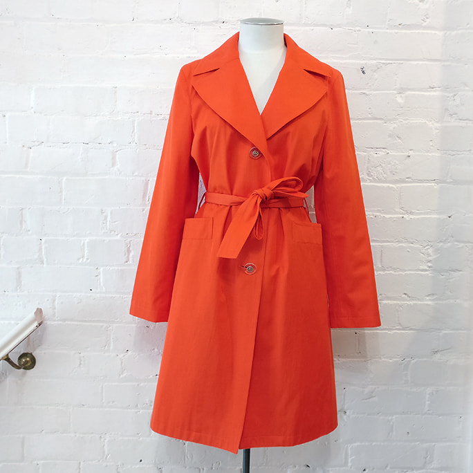 Lined cotton mix trench coat with pockets.