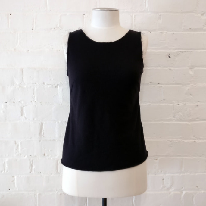 Fitted wool vest.