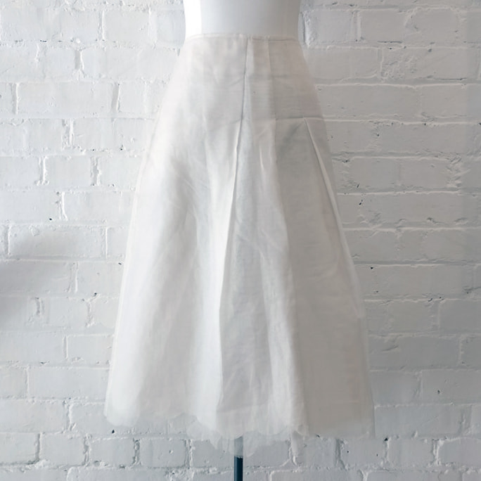 Silk organza cream layered skirt.