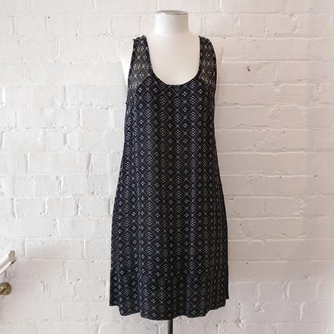 Sleeveless digital print dress.