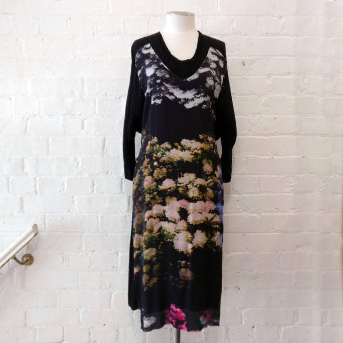 Floral print black dress with pockets.