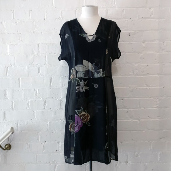 Black silk dress with floral print.