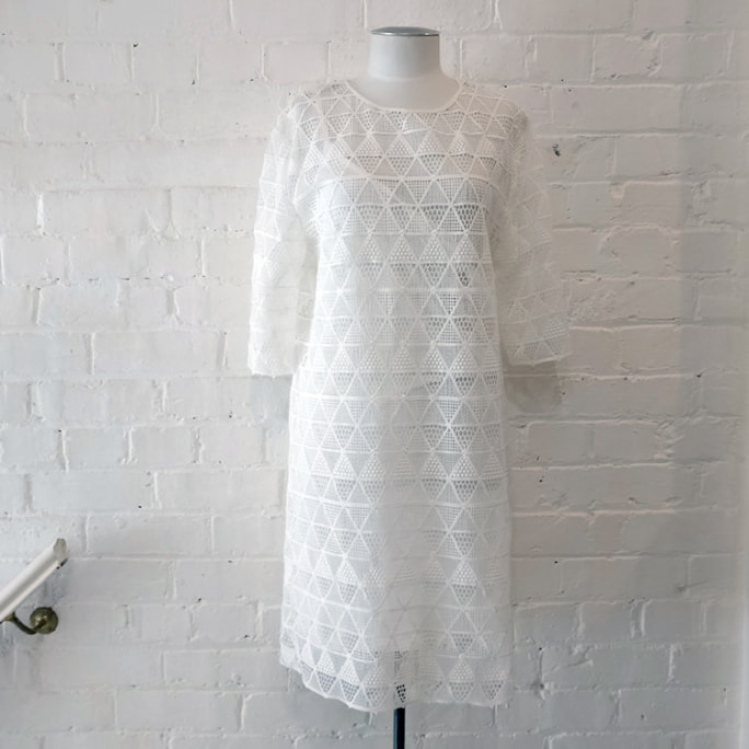 Woven dress with petticoat.