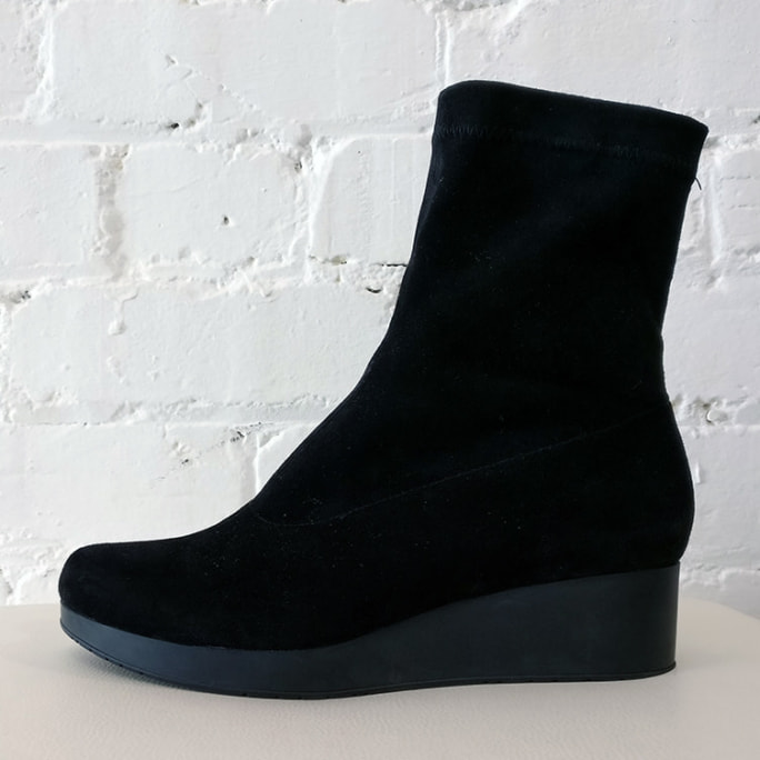 Stretch fabric ankle boot with wedge.