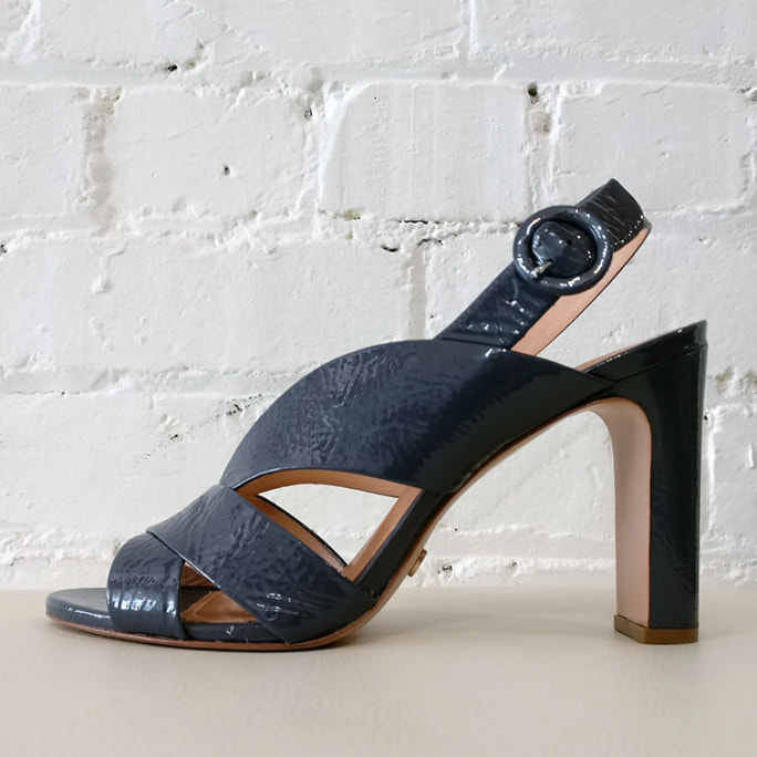 Patent leather high heel sandal.
