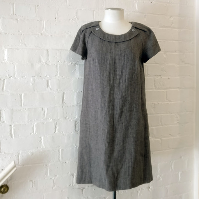 Cap sleeve woven cotton dress with pockets.